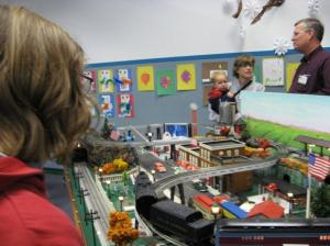 That's K, hiding behind his hair from the camera at a model train event we dragged him to in December
